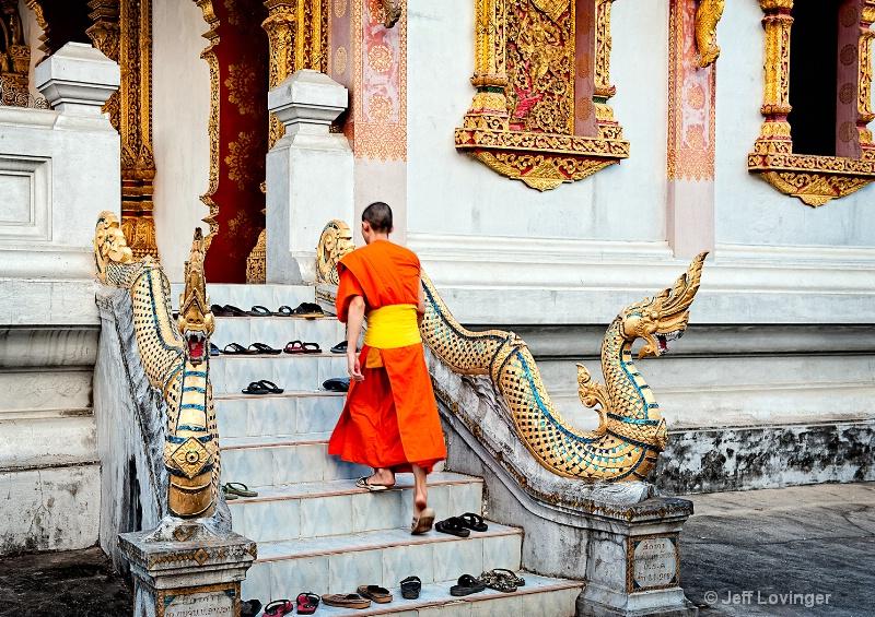 Luang Prabang, Laos, Monk on Stairs - ID: 10505628 © Jeff Lovinger
