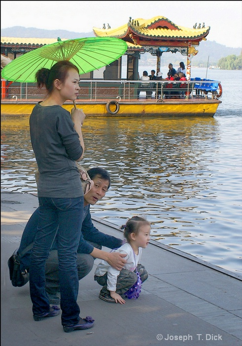 #497 westlake woman with green umbrella & child - ID: 10949474 © Joseph T. Dick