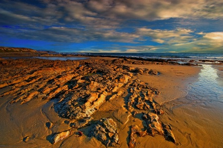 Of Golden Rocks and Sand