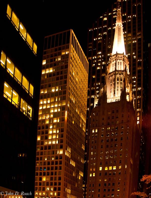 Steeple Among Skyscrapers - ID: 11660408 © John D. Roach