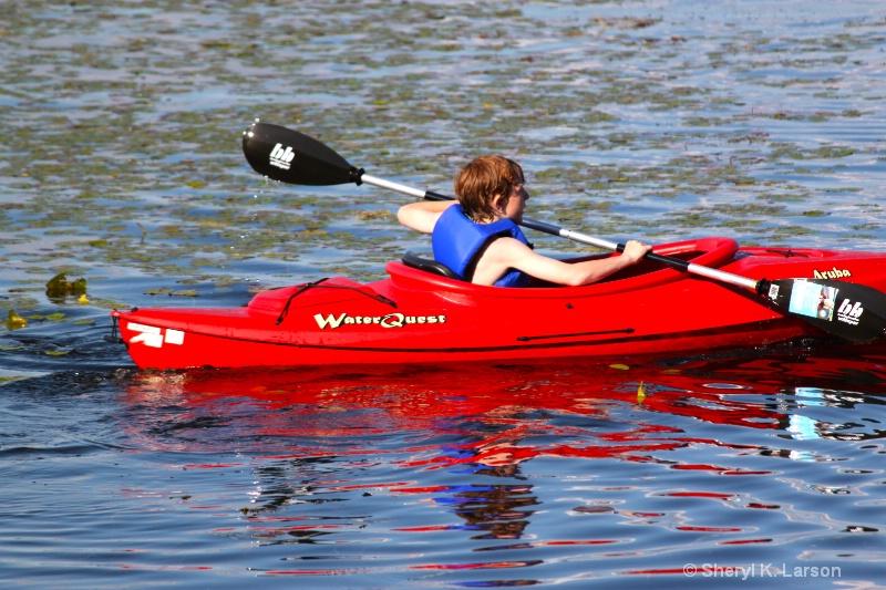 Theo Kayaking - ID: 12917644 © Sheryl K. Larson