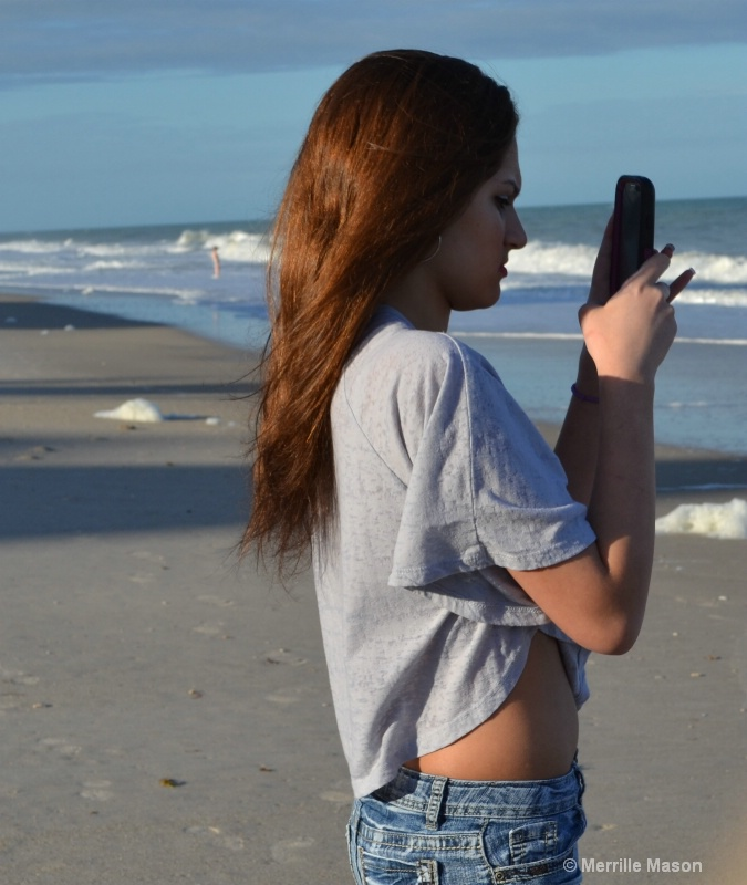 a picture of her, taking a picture - ID: 14346641 © Merrille Mason