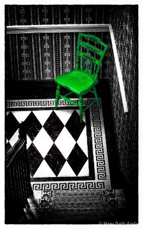 Green Chair at the Bottom of the Stairs