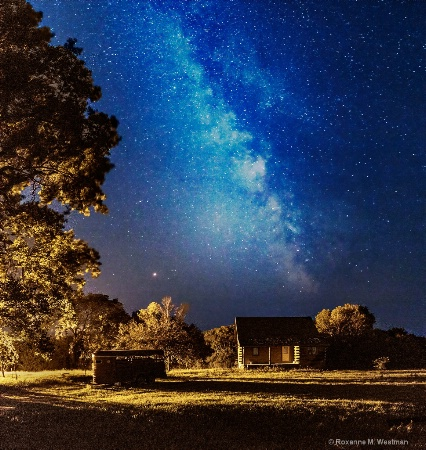 Milky way and cabin in the woods